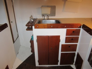 Another view of the galley, stove is to the right.  The ladder from the cockpit normally sits directly over the sink