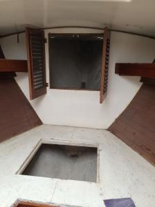 V-Berth - anchor locker farthest back through the 2 little doors.