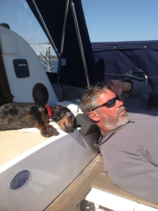 The men of the boat taking a much deserved nap in the sun