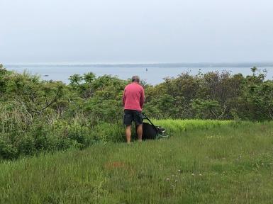 Brian cutting grass
