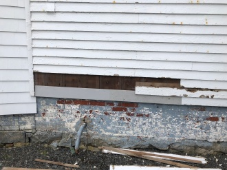 Missing Clapboards on the Keepers House
