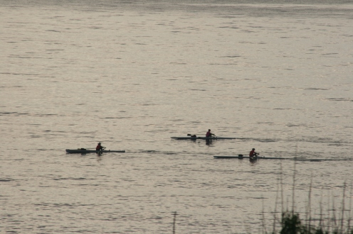 The early morning rowers go past the island just after sunrise