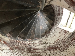 The lighthouse stairs looking down. It is interesting how basic the stairs are but it was build in 1820 before lighthouse structures became a show place for artisans