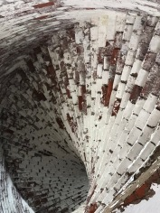 This is the view of stairs from below, the granite steps are supported by a underlayment of bricks