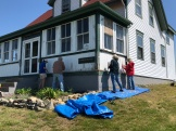 The scraping team working on the Keeper's Cottage front porch
