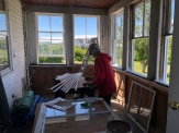 Roberta sanding the window supports