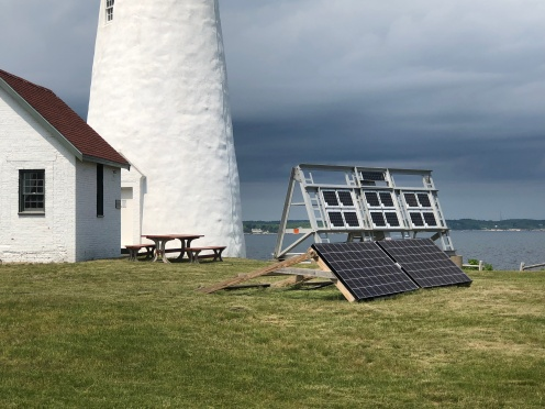 The solar panels in the foreground energize the keeper cottage and the panels higher up are for the lighthouse
