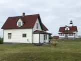 The Assistant Keeper Cottage in the foreground and the Keeper Cottage close to the lighthouse