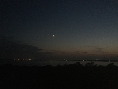 The crescent moon and Venus shining above the city of Salem