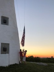 Lowering the flag at sunset