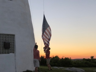 Nate & Nick lower the flag at sunset